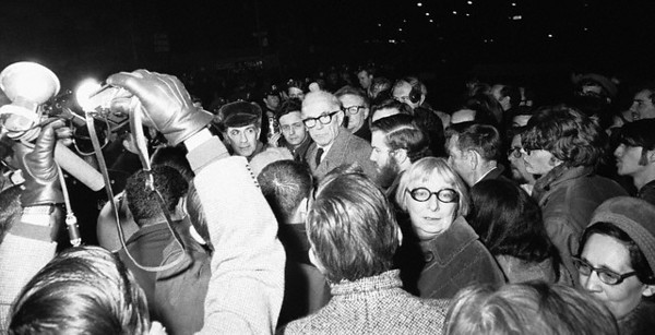 05 Dec 1967, New York, New York, USA --- White-haired Dr. Benjamin Spock (center) is surrounded by fellow protesters during an anti-draft demonstration outside the Armed Forces Induction Center at Whitehall Street. The noted pediatrician was among more than 260 arrested during the four-hour demonstration. Also facing the camera at lower right is author Jane Jacobs. --- Image by © Bettmann/CORBIS