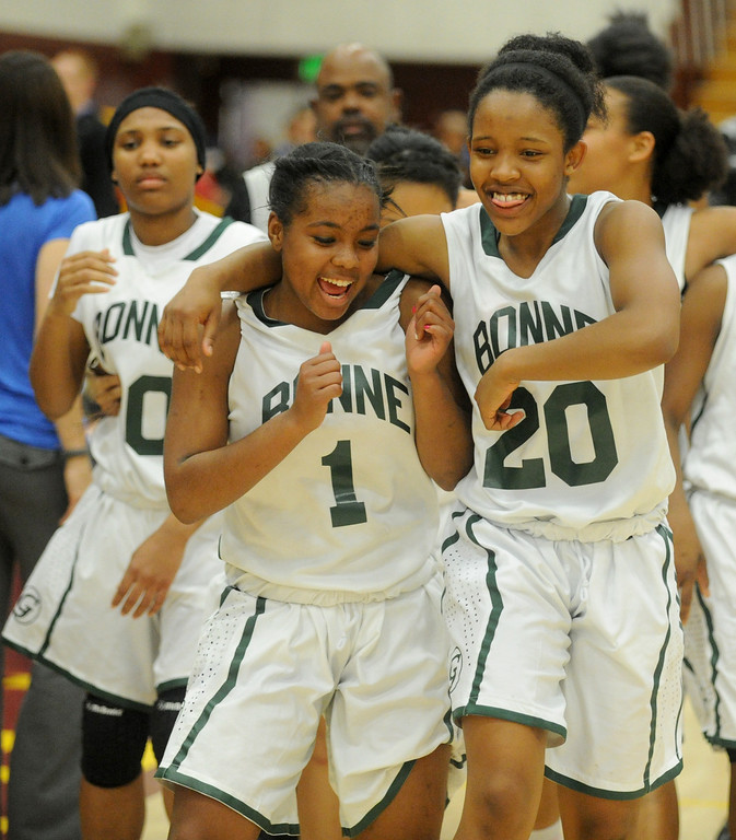 . 02-23-2012--(LANG Staff Photo by Sean Hiller)- Narbonne\'s  Kayla Brady (1), left, and Jade Everage (20) celebrate after defeating El Camino Real 47-39 in Saturday\'s L.A. City Section Division I semifinal girls basketball game.