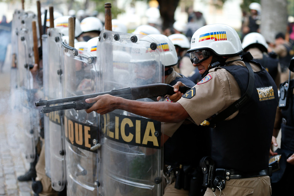 . Riot police fires rubber bullets to demonstrators during a protest against the 2014 World Cup in Belo Horizonte, Brazil, Thursday, June, 12, 2014. (AP Photo/Victor R. Caivano)
