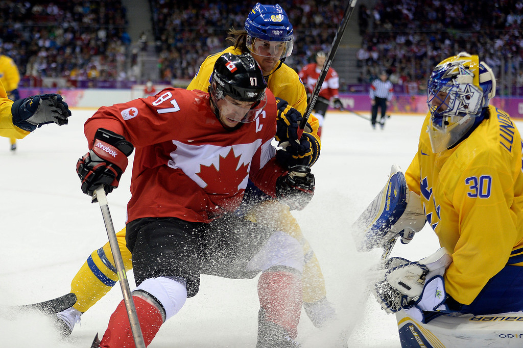 . Erik Karlsson (65) of Sweden gets physical with Sidney Crosby (87) of the Canada as Henrik Lundqvist (30) of Sweden defends the goal during the first period of the men\'s ice hockey gold medal game. Sochi 2014 Winter Olympics on Sunday, February 23, 2014 at Bolshoy Ice Arena. (Photo by AAron Ontiveroz/ The Denver Post)