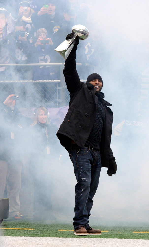 . Baltimore Ravens linebacker Ray Lewis holds up the Vince Lombardi NFL football championship trophy during a celebration of the team\'s Super Bowl championship at M&T Bank Stadium in Baltimore Tuesday, Feb. 5, 2013. The Ravens defeated the San Francisco 49ers 34-31 in Super Bowl XLVII on Sunday. (AP Photo/Steve Ruark)