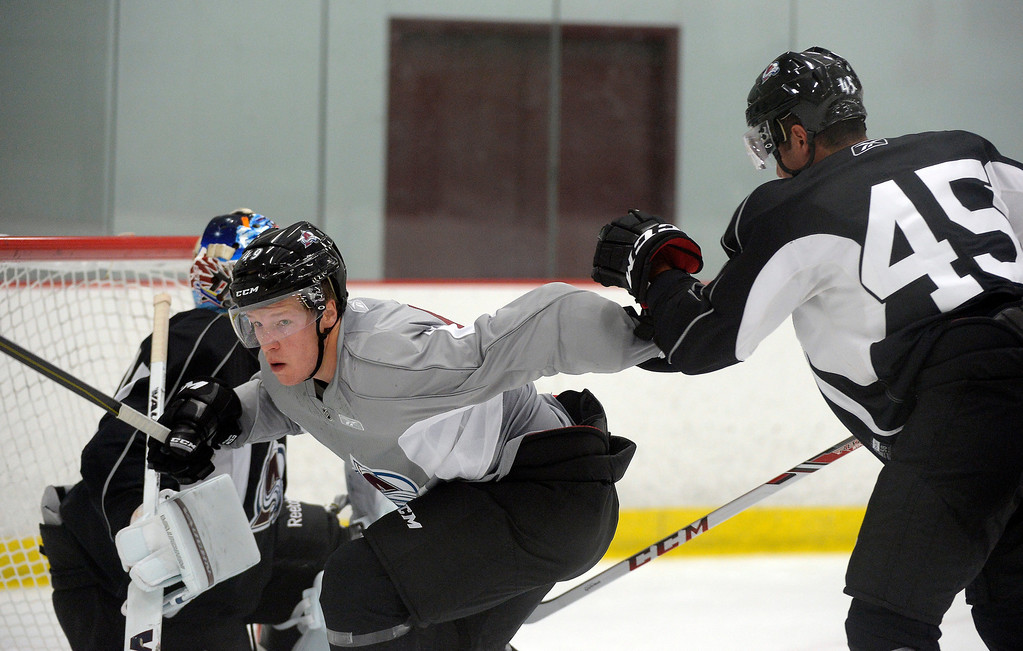. Mikael Tam (45) and Gabriel Desjardins (49) batle for position in front of the goal on the first day of Avalanche rookie camp September 8, 2013 at Family Sports. (Photo by John Leyba/The Denver Post)