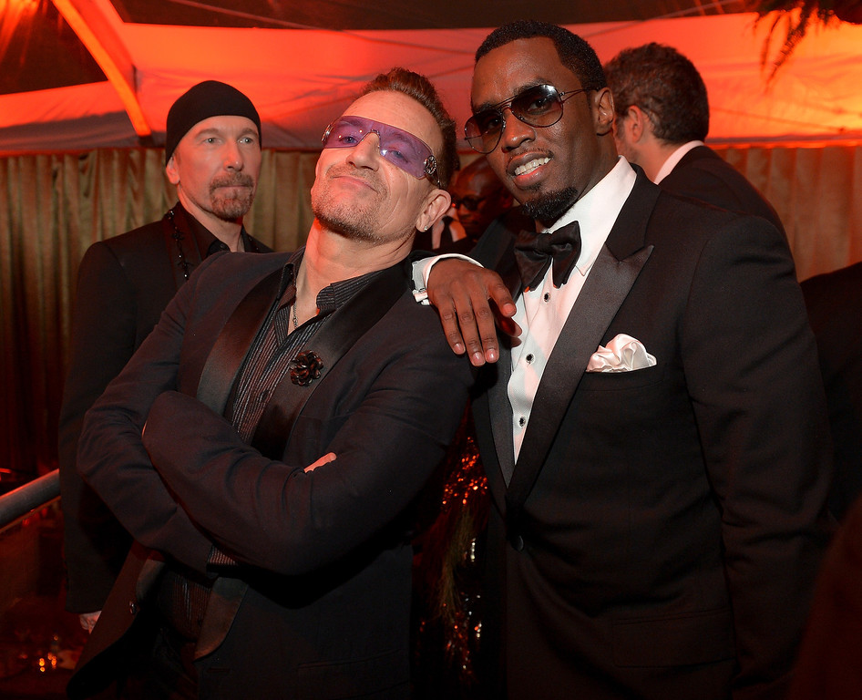 . Bono and Sean Combs attend The Weinstein Company & Netflix\'s 2014 Golden Globes After Party presented by Bombardier, FIJI Water, Lexus, Laura Mercier, Marie Claire and Yucaipa Films at The Beverly Hilton Hotel on January 12, 2014 in Beverly Hills, California.  (Photo by Charley Gallay/Getty Images for The Weinstein Company)