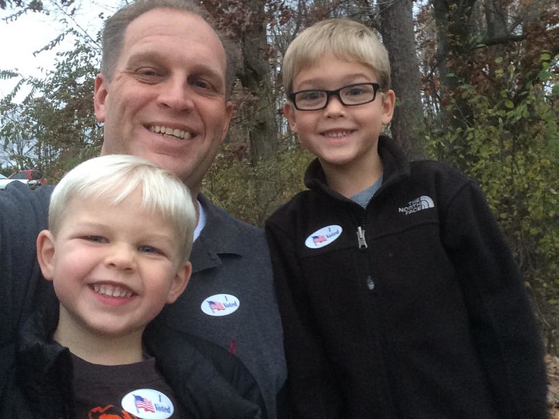 . David Castle of Oxford Township with his sons Nathan and Zachary after he voted at Christ the King Church