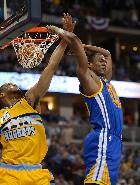 . DENVER, CO. - APRIL 23: Golden State Warriors small forward Harrison Barnes (40) dunks the ball behind his head against Denver Nuggets power forward Anthony Randolph (15) in the third quarter. The Denver Nuggets took on the Golden State Warriors in Game 2 of the Western Conference First Round Series at the Pepsi Center in Denver, Colo. on April 23, 2013. (Photo by John Leyba/The Denver Post)