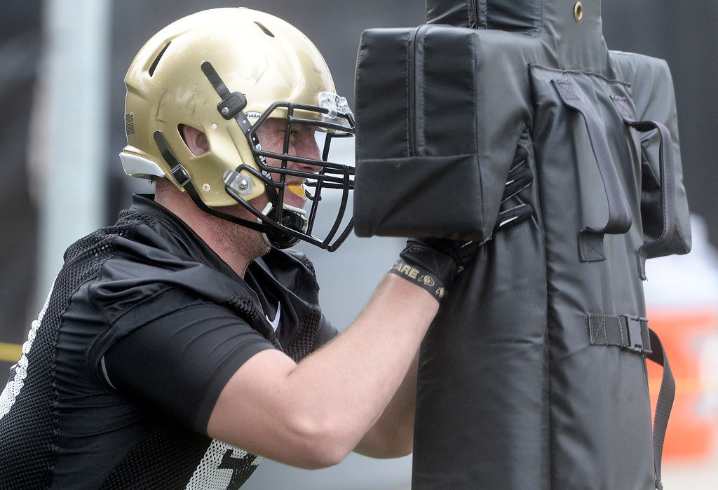 . University of Colorado defensive lineman Jon Wilson hits the sled during the second fall football practice on Wednesday, Aug. 7, at the CU practice fields. For more photos of practice go to www.dailycamera.com Jeremy Papasso/Camera