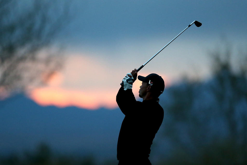 . MARANA, AZ - FEBRUARY 21:  Tiger Woods hits his second shot on the 17th hole during the first round of the World Golf Championships - Accenture Match Play at the Golf Club at Dove Mountain on February 21, 2013 in Marana, Arizona. Round one play was suspended on February 20 due to inclimate weather and is scheduled to be continued today.  (Photo by Jed Jacobsohn/Getty Images)