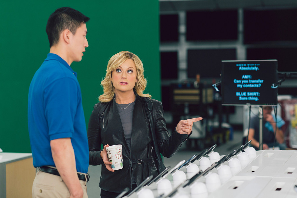 """. This  image provided by Best Buy, shows Amy Poehler on the set of the Company\'s Super Bowl commercial.  Best Buy\'s 30-second ad in the first quarter stars Amy Poehler, star of NBC\'s \""""Parks and Rec,\"""" asking a Best Buy employee \""""lots of questions.\"""" (AP Photo/Best Buy)"""