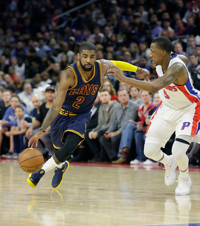 . Cleveland Cavaliers guard Kyrie Irving (2) drives on Detroit Pistons guard Kentavious Caldwell-Pope (5) during the second half in Game 4 of a first-round NBA basketball playoff series, Sunday, April 24, 2016 in Auburn Hills, Mich. (AP Photo/Carlos Osorio)