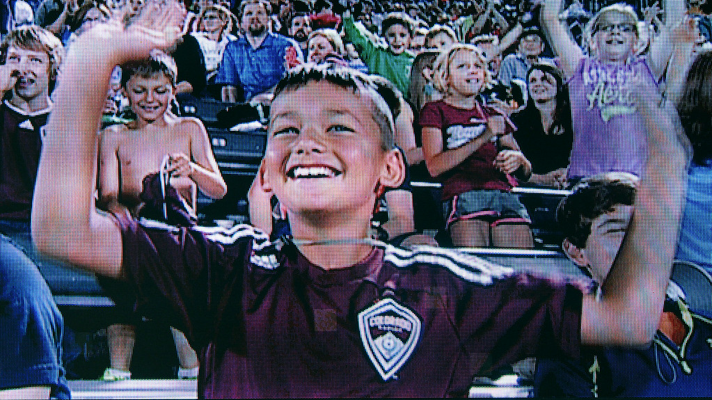 . A young Rapids\' fan spotted himself on the big screen during second half action Friday night. The Colorado Rapids defeated Chivas USA 3-0 at Dick\'s Sporting Goods Park Friday night, July 25, 2014. Photo by Karl Gehring/The Denver Post