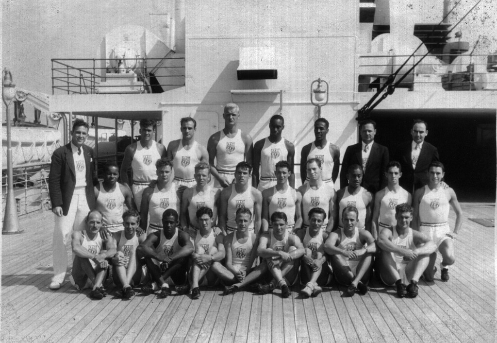 . Team photo of U.S. Olympic track team on board the Queen Mary in New York City before departing for Berlin. (Howells center bottom row, Owens top row, second athlete from right) Photo Courtesy Nancy Mate