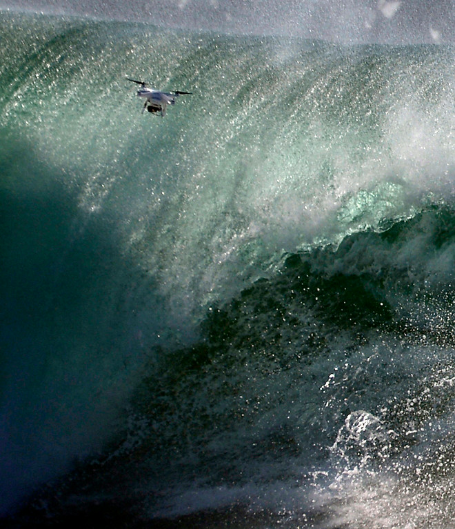 . Aug 27,2014, Newport Beach CA. A drone gets in close for photos of the big waves, as surfers go head on a second day with 20-25 foot waves at the Wedge Wednesday morning. The big surf affect is from hurricane Marie down south and is last a few days with big surf hitting the south facing beaches. Photo by Gene Blevins/LA Daily News