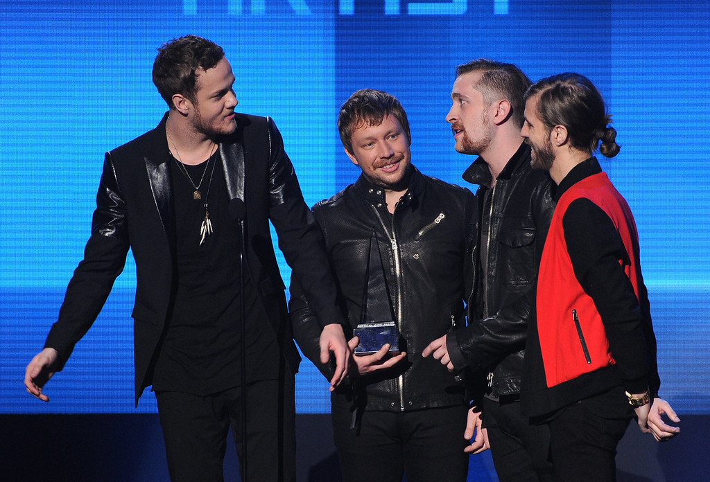 . Musicians (L-R) Dan Reynolds, Ben McKee, Dan Platzman, and Wayne Sermon of Imagine Dragons accept the Favorite Alternative Artist award onstage during the 2013 American Music Awards at Nokia Theatre L.A. Live on November 24, 2013 in Los Angeles, California.  (Photo by Kevin Winter/Getty Images)