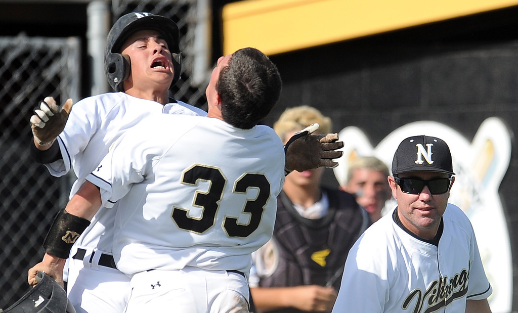 . Northview\'s Brian Centeno (33) reacts with Alex Labor, left, as head coach Darren Murphy looks on after scoring in the fourth inning of a prep baseball game against Baldwin Park at Northview High School on Tuesday, April 23, 2012 in Covina, Calif. Northview won 8-2.    (Keith Birmingham/Pasadena Star-News)