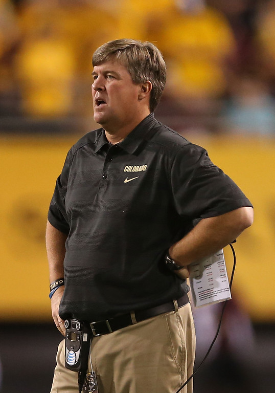 . TEMPE, AZ - OCTOBER 12:  Head coach Mike MacIntyre of the Colorado Buffaloes watches from the sidelines during the college football game against the Arizona State Sun Devils at Sun Devil Stadium on October 12, 2013 in Tempe, Arizona.  (Photo by Christian Petersen/Getty Images)
