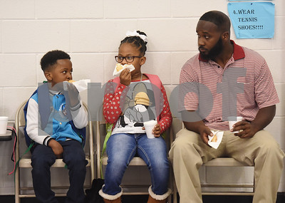 doughnuts-bring-dads-and-students-together-for-breakfast-at-bell-elementary