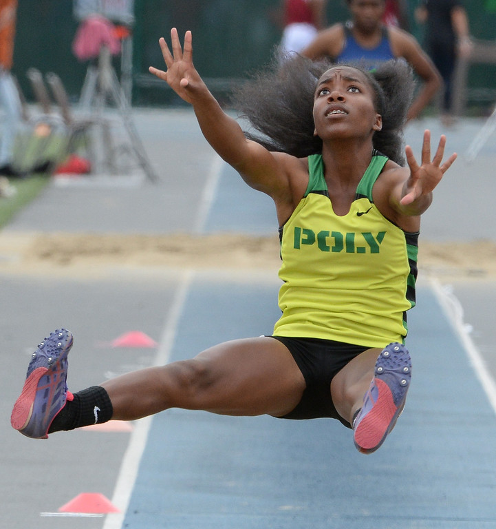 . Long Beach Poly\'s Onyx Gaston competes in the division 1 long jump during the CIF Southern Section track and final Championships at Cerritos College in Norwalk, Calif., on Saturday, May 24, 2014.   (Keith Birmingham/Pasadena Star-News)