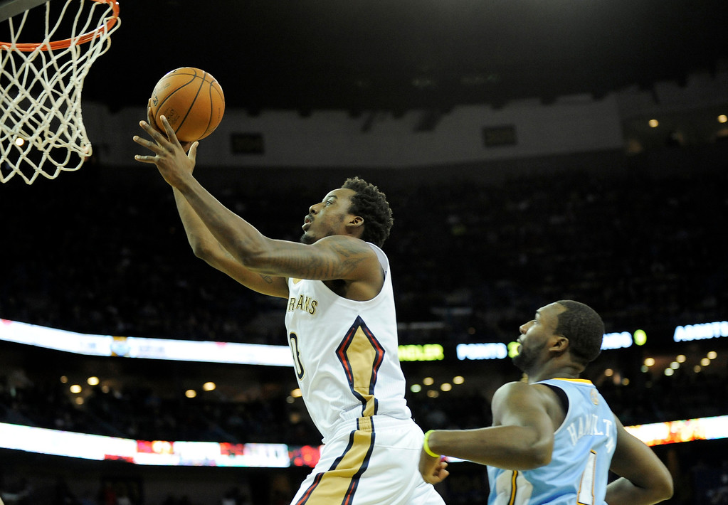. New Orleans Pelicans forward Al-Farouq Aminu (0) shoots in front of Denver Nuggets guard Jordan Hamilton (1) in the second half of an NBA basketball game in New Orleans, Friday, Dec. 27, 2013. New Orleans won 105-89. (AP Photo/Stacy Revere)