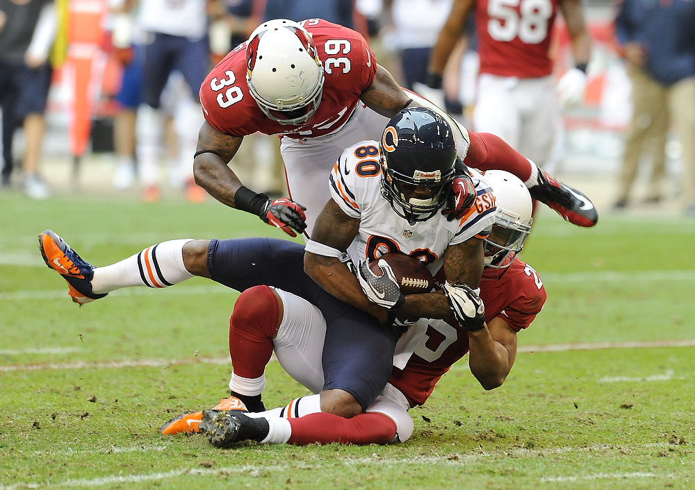 . Earl Bennett #80 of the Chicago Bears is tackled by Kerry Rhodes #25 and James Sanders #39 of the Arizona Cardinals at University of Phoenix Stadium on December 23, 2012 in Glendale, Arizona. Bears won 28-13. (Photo by Norm Hall/Getty Images)