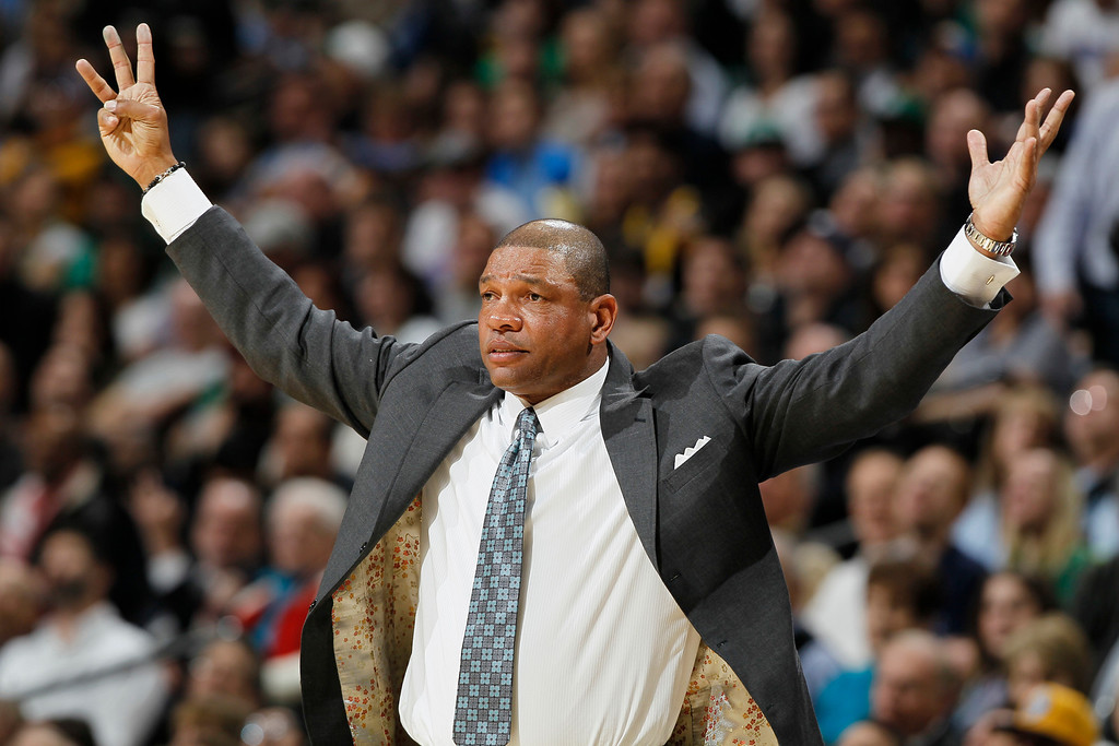 . Boston Celtics coach Doc Rivers gestures to referees that the Celtics should be awarded three points on a shot against the Denver Nuggets in the third quarter of the Nuggets\' 97-90 victory in an NBA basketball game in Denver on Tuesday, Feb. 19, 2013. (AP Photo/David Zalubowski)