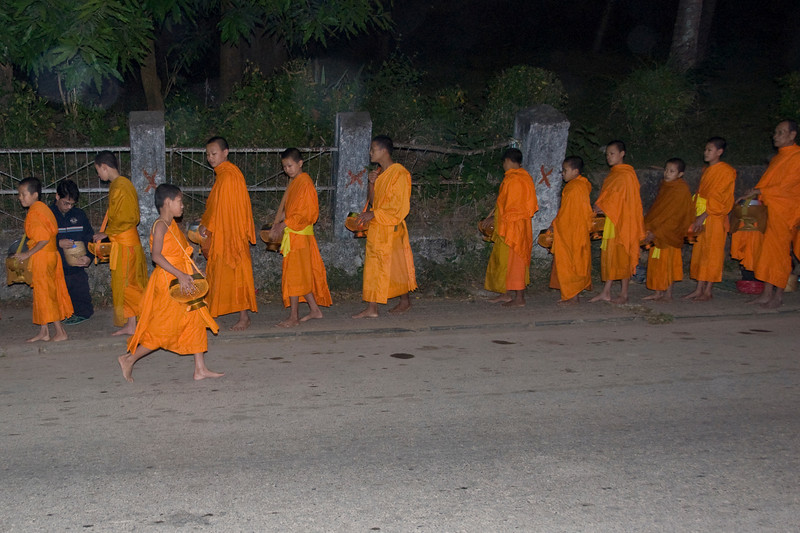 Monks during alms ceremony at early morning in Luang Prang, Laos