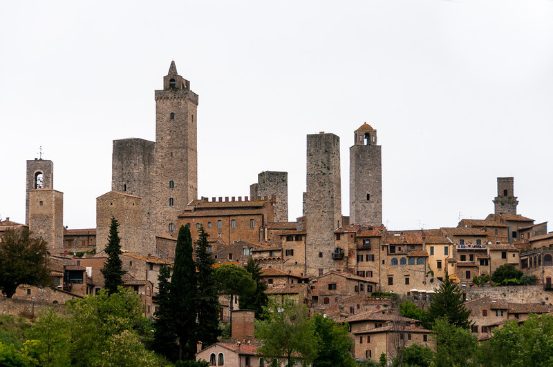 Panoramic shot of the towers in San Gimignano and houses - Italy