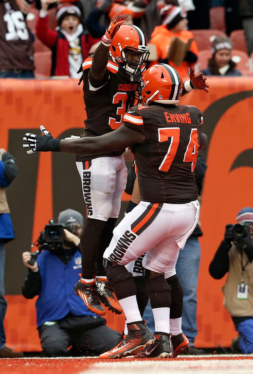 . Cleveland Browns running back Isaiah Crowell (34) is congratulated by Cameron Erving (74) after Crowell rushed for an eighth yard touchdown in the first half of an NFL football game against the San Diego Chargers, Saturday, Dec. 24, 2016, in Cleveland. (AP Photo/Aaron Josefczyk)