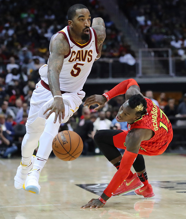 . Cleveland Cavaliers guard J.R. Smith (5) steals the ball from Atlanta Hawks guard Dennis Schroder during the second half of an NBA basketball game, Thursday, Nov. 30, 2017, in Atlanta. The Cavaliers won 121-114. (Curtis Compton/Atlanta Journal-Constitution via AP)