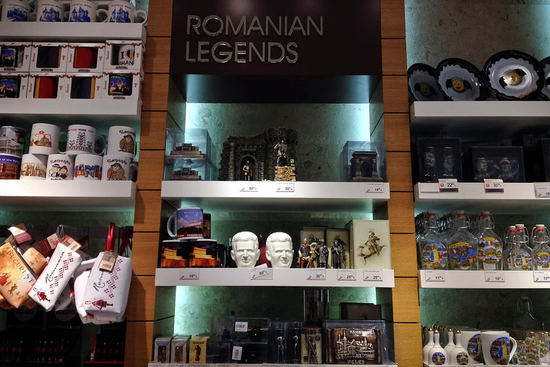 . A picture taken on Dec. 7, 2014 shows a porcelain piggybank representing communist dictator Nicolae Ceausescu, next to legendary ancient and medieval kings representations on sale in the duty free shop of the Henri Coanda international airport in Otopeni, Romania.  (AP Photo/Vadim Ghirda)