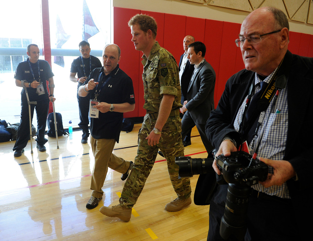 . COLORADO SPRINGS, CO - MAY 11: Britain\'s Prince Harry, center, walks with British Armed Forces leader/coach, Martin Colclough, for a meet and greet with British athletes at the United States Olympic Training Center  before the 2013 Warrior Games Saturday morning, May 11th, 2013.(Photo By Andy Cross/The Denver Post)