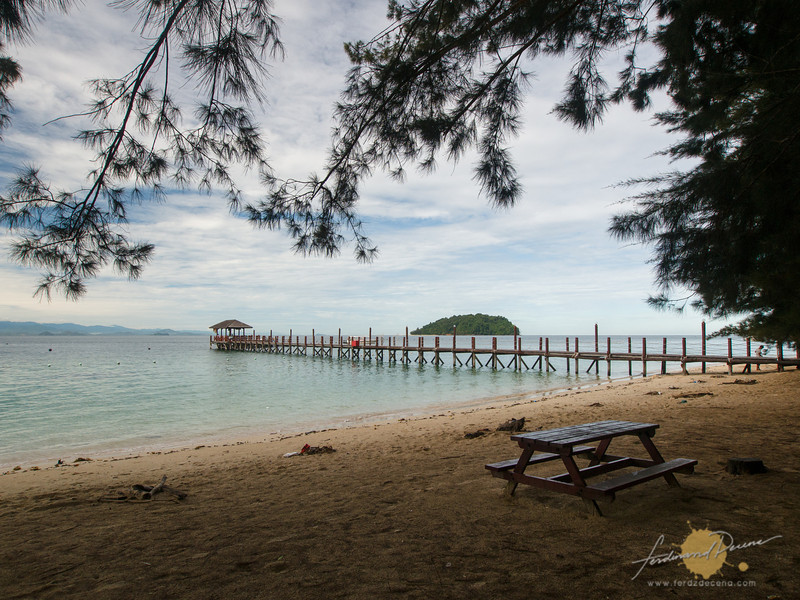 The beach and jetty view at Palau Manukan in the morning