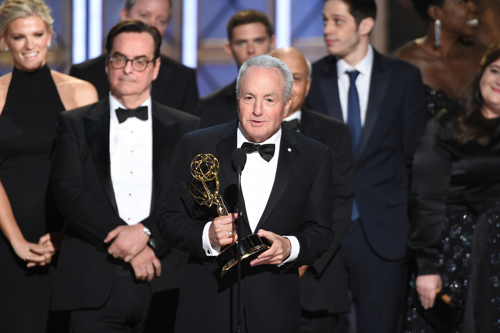 """. Lorne Michaels and the cast of \""""Saturday Night Live\"""" accept the award for outstanding variety sketch series for \""""Saturday Night Live\"""" at the 69th Primetime Emmy Awards on Sunday, Sept. 17, 2017, at the Microsoft Theater in Los Angeles. (Photo by Phil McCarten/Invision for the Television Academy/AP Images)"""