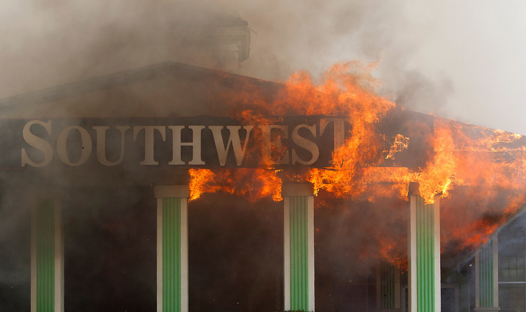. Flames erupt from the Southwest Inn on U.S. 59 in Houston on Friday, May 31, 2013. (AP Photo/Houston Chronicle, Cody Duty)