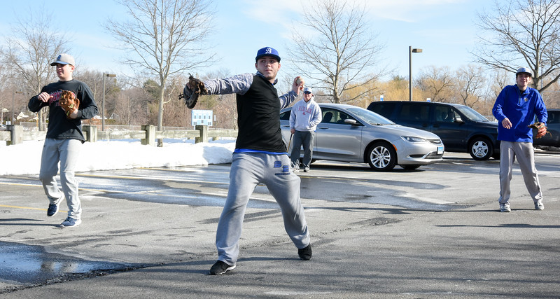 032017  Wesley Bunnell   Staff  Prospective members of the Varisty and Junior Varsity Bristol Eastern Baseball team practice in a parking lot in the front of the school due to snow covered fields on the first day of spring Mar. 20, 2017.