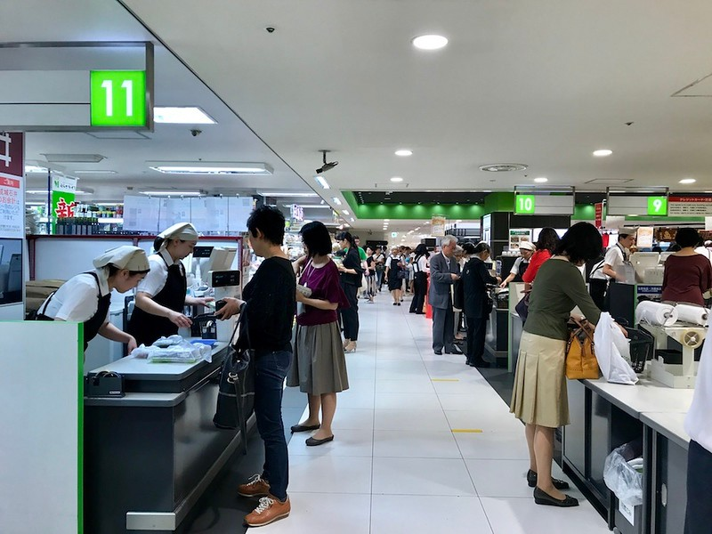 The view from the front of Uoriki - cashiers to the left, bagging tables to the right.