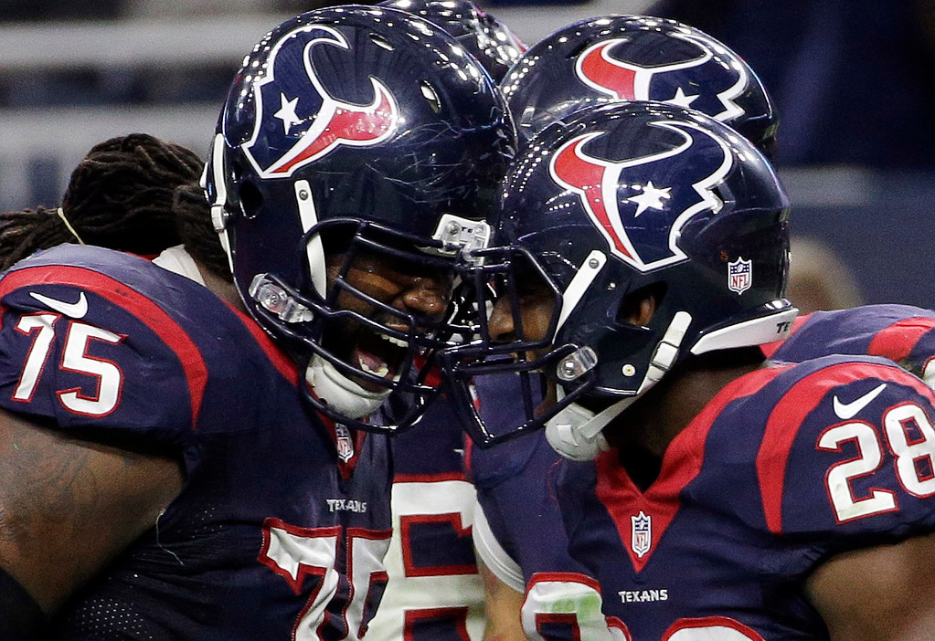 . Houston Texans running back Alfred Blue (28) celebrates with tackle Derek Newton (75) after scoring a touchdown against the Jacksonville Jaguars during the first half of an NFL football game Sunday, Dec. 28, 2014, in Houston. (AP Photo/David J. Phillip)