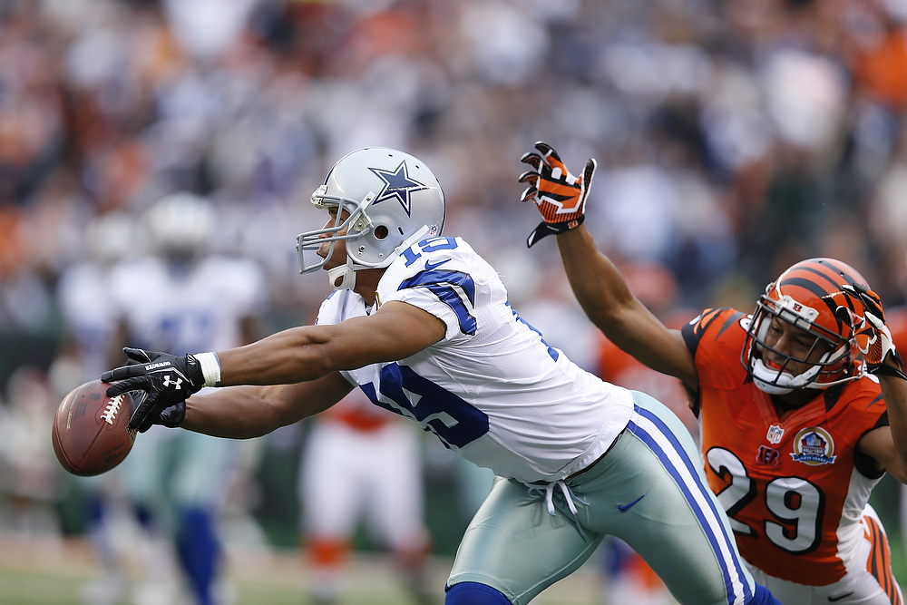 . Miles Austin #19 of the Dallas Cowboys drops a pass ahead of Leon Hall #29 of the Cincinnati Bengals during the game at Paul Brown Stadium on December 9, 2012 in Cincinnati, Ohio. (Photo by Joe Robbins/Getty Images)
