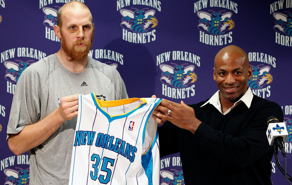 . New Orleans Hornets center Chris Kaman, left, poses for photos with general manager Dell Demps during an NBA basketball news conference in New Orleans on Saturday, Dec. 17, 2011. The Hornets acquired Chris Kaman in a trade that sent Chris Paul to the Los Angeles Clippers. (AP Photo/Jonathan Bachman)