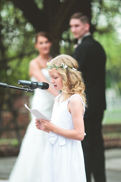girl performing wedding reading