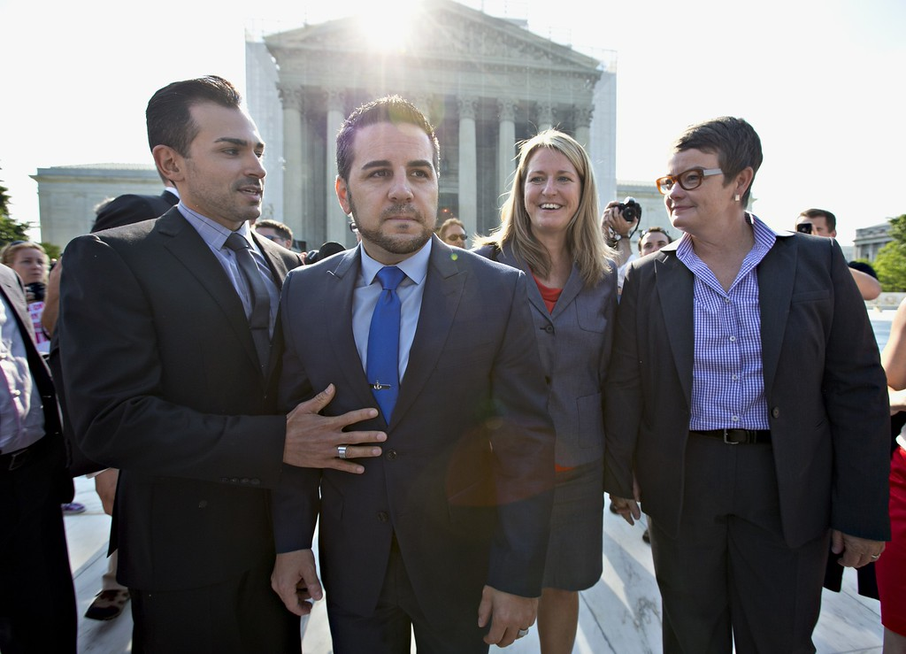 . Arriving at the Supreme Court in Washington, Wednesday, June 26, 2013, on a final day for decisions in two gay marriage cases are plaintiffs in the California Proposition 8 case, from left, Paul Katami, his partner Jeff Zarrillo, and Sandy Stier and her partner Kris Perry. (AP Photo/J. Scott Applewhite)