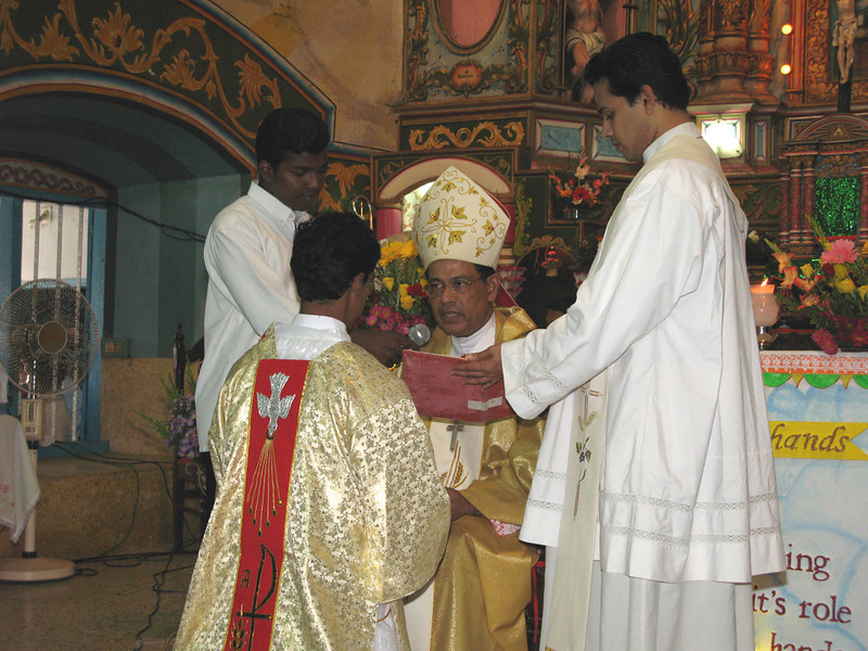 Each deacon then goes to the bishop and kneels before him, as the bishop presents him with the Book of the Gospels.