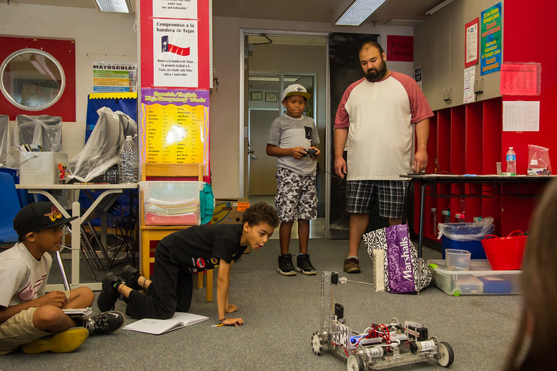 Students are given a chance to comand the robot.
