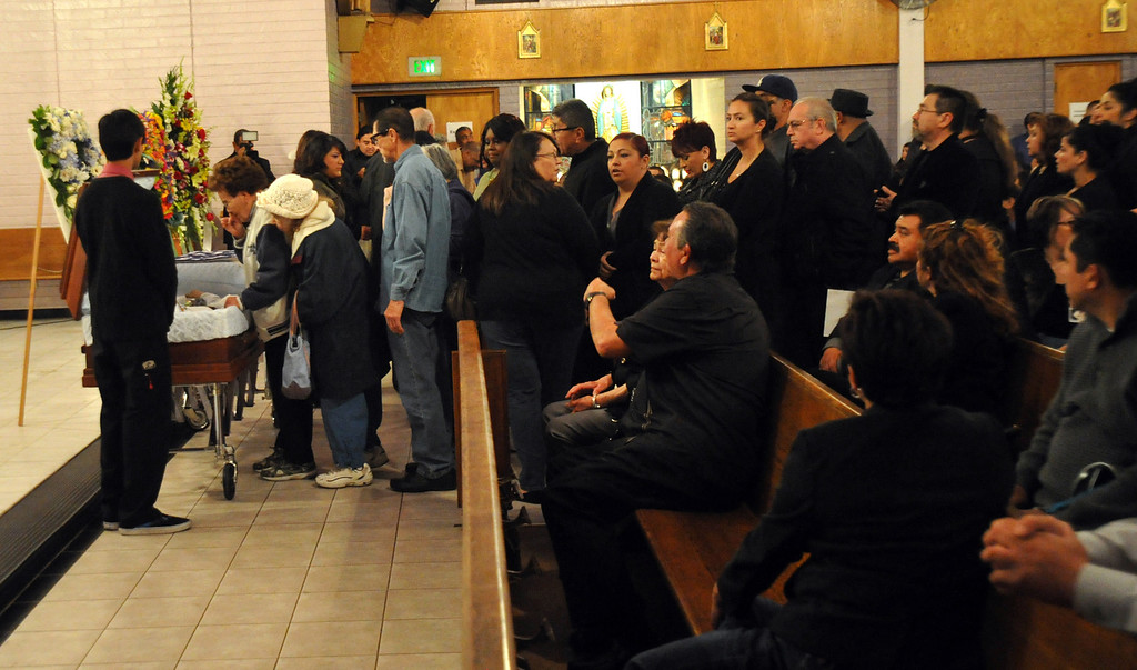 ". Mourners gather to remember restaurant owner Manuel Rojas during the Rosary service at Assumption Church in Boyle Heights on February 25, 2013. Rojas, owner of Manuel\'s Original El Tepeyac Cafe, he was known for making the famous ""Hollenbeck\"" burrito. (SGVN/Staff Photo by Keith Durflinger)"