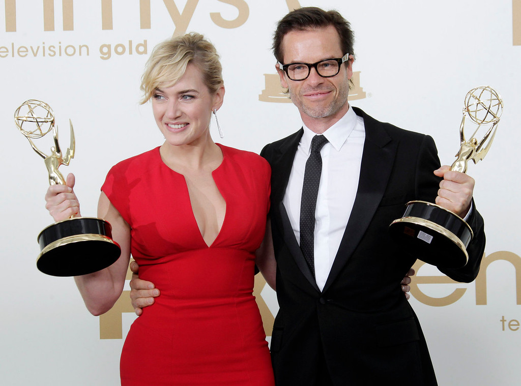 """. \""""Mildred Pierce\"""" cast members Kate Winslet, left and Guy Pearce hold the Emmys for best actress and best supporting actor in a miniseries or movie backstage at the 63rd Primetime Emmy Awards on Sunday, Sept. 18, 2011 in Los Angeles. (AP Photo/Jae Hong)"""