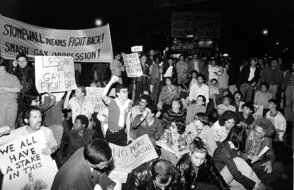 """. Hundreds of gay rights activists protest the \""""diminished capacity\"""" verdict against former Supervisor Dan White for the double assassination of Mayor George Moscone and the city\'s first openly gay Supervisor, Harvey Milk at Sheridan Square in New York\'s Greenwich Village section, Tuesday night, May 22, 1979.  The demonstrators gathered before a police station then marched to the square, calling on Mayor Koch to state where he stands on protection for \""""his lesbian and gay constituences.\""""  One sign reads, \""""Stop Police Brutality Against Lesbians and Gay Men.\""""  (AP Photo)"""