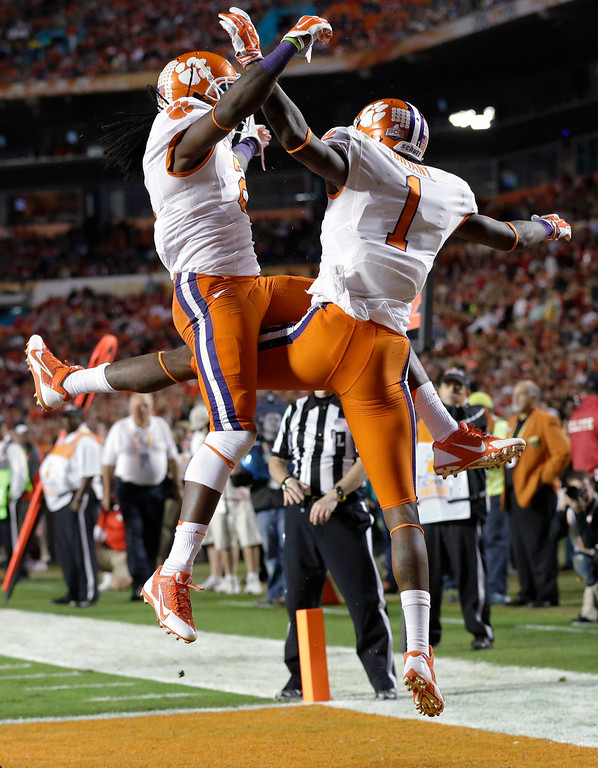 . Clemson wide receiver Martavis Bryant  (1) celebrates with wide receiver Sammy Watkins, left, after scoring a touchdown during the first half of the Orange Bowl NCAA college football game against Ohio State, Friday, Jan. 3, 2014, in Miami Gardens, Fla. (AP Photo/Wilfredo Lee)