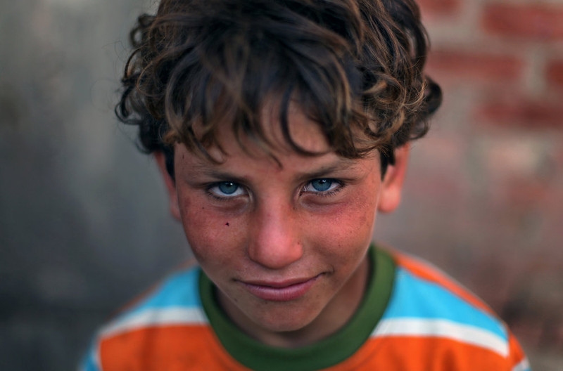 . Palestinian refugee Ahmed Sameer, 10, poses for a photograph in Gezirat al-Fadel village, Sharqiya, about 150 kilometers (93 miles) east of Cairo, Egypt.  (AP Photo/Khalil Hamra)