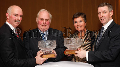 Richard and Jill Hunniford, Portadown were the winners in the Co Armagh UFU Oat and Wheat Competitions. They are pictured getting their awards at the County Armagh Ulster Farmers' Union Annual Dinner in Newry from Billy Morton, Chairman, Co Armagh UFU, left and Ian Marshall, right, UFU President. Photograph: Columba O'Hare