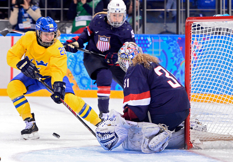 . epa04083301 Goalkeeper Jessie Vetter (R) of the USA blocks a shot against Michelle Lowenhielm (L) of Sweden in the second period during the semi final match between USA and Sweden at the Shayba Arena in the women\'s Ice Hockey tournament at the Sochi 2014 Olympic Games, Sochi, Russia, 17 February 2014.  EPA/LARRY W. SMITH