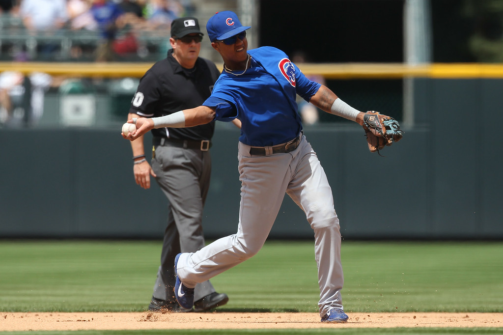 . Starlin Castro #13 of the Chicago Cubs throws to first base for an out in the first inning against the Colorado Rockies at Coors Field on August 7, 2014 in Denver, Colorado. (Photo by Trevor Brown, Jr./Getty Images)